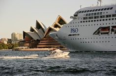 The P&O Cruise ship Pacific Jewel passes right in front of the Opera house, Sydney on a winters afternoon.