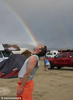 Tasted too much rainbow: The incredible juxtaposition of elements in this image makes it seem as though this festival-goer is projectile vomiting a rainbow