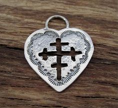 Just added this charm/pendant to my Etsy findings shop.....made by a local Santa Fe artist....love it! Large Unique Stamped Heart Charm with Carved-out Cross by VDIJewelryFindings, $22.50