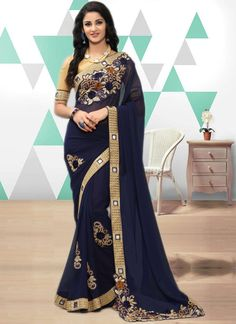 Get a classy and elegant look by wearing this blue georgette with embroidery, lace work and beige blouse. Bollywood Designer Sarees, Indian Designer Sarees, Latest Designer Sarees, Designer Sarees Collection, Saree Collection, Latest Indian Saree, Indian Sarees, Lehenga Style Saree, Bollywood Party