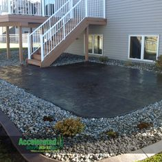 Stamped concrete patio right off of your deck offers another space for entertaining.