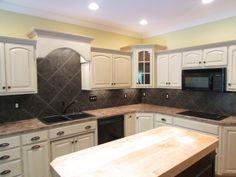The kitchen is extremely large with a hearth sitting area with the double sided fireplace and large eating area that leads on to a vaulted screened porch, large patio and water feature is one of a kind!  http://louisvillehomeseller.com/idx/mls-1389948-3823_garwood_pl_louisville_ky_40241