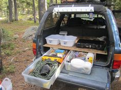 4runner storage solution 2: totes pull out like big drawers (they even have their own wheels): recovery equipment on left, camp kitchen on right