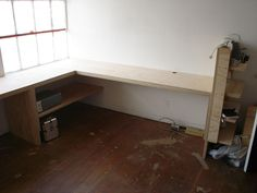 """Custom Built Office Desk   Custom desk made from 1"""" plywood installed in industrial office space."""