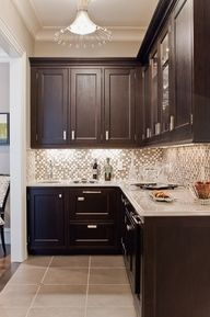Espresso kitchen cabinets. Love the combonation of the dark cabnets with light countertops, backsplash and tile!
