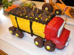 This is the second cake I made for Nathan's 2nd birthday party, which was construction themed.  The instructions are here, but I modified it a bit.  http://www.parenting.com/article/how-to-make-a-dump-truck-cake