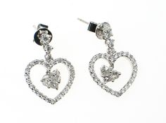 A pair of elegant diamond earrings set in 18 K white gold. They contain round brilliant diamonds set in a heart shape with princess cut diamonds floating in the centre. Diamond weight is 1.48ct and they are G/H colour and VS1/2 clarity
