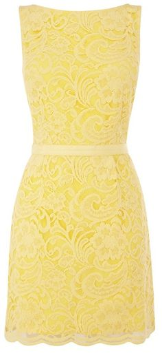 Yellow Dress with Light Yellow Lace Overlay.  Bridesmaids in yellow dresses- different style, same color?  Or maybe just Mother of the Bride?  Got to have yellow dress in there somewhere.