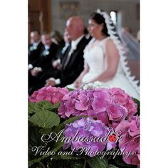 #BrideAndGroom at their #weddingceremony with #hydrangeas in the foreground…
