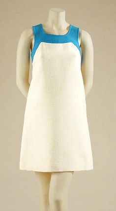 Pierre Cardin Pinafore Dress   French, 1960s   Of cream wool with azure neckline trim and shoulder straps buttoning at back