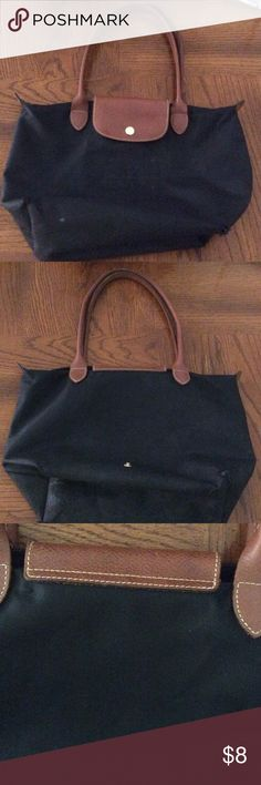 Longchamp Le pliage small black tote travel bag Longchamp Le pliage small black tote travel bag, brown leather strap and flap. Fixer upper condition is poor, no zipper pull on track. Holes in corners. Leather is very good condition. Use as craft project and decorate. Longchamp Bags Totes
