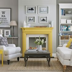Charcoal and white living room with yellow hints . . . . bit daring to paint the fireplace yellow but looks fab!