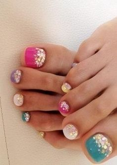 This pedicure is the perfect choice for you if you love for your nail art to be bold and beautiful! Break out all of your polishes and paint your toenails in a variety of bright hues (the more random, the better!). Then use a chunky glitter topcoat only at the base of each nail to achieve this shimmery look.