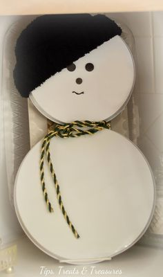 Let's Build a Snowman! DIY with stove top burner covers - spray paint, buttons, beanie, scarf & a binder clip - so easy