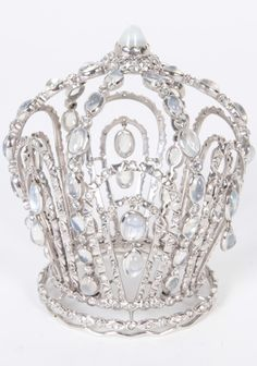 Bismarck Family Crown - House of Koch, Chignon crown, Moonstones and diamonds set in an elaborate platinum mount, c. 1900, original leather box.