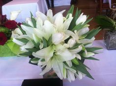 All white bridal bouquet.. White lilies with white tulips..