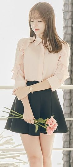 Simple outfit, like that there are ruffles going down the sides.