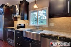 A transitional style kitchen featuring Espresso stained cabinets, granite countertops, stone backsplash, and stainless steel appliances. Discount Kitchen Cabinets, Espresso Cabinets, Staining Cabinets, Stone Backsplash, Neutral Colour Palette, Stainless Steel Appliances, Transitional Style, Kitchen Styling, Granite Countertops