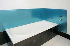 Acrylic Splashback behind a Bath , colour Ozzie Blue. Installed by OzzieSplash