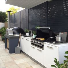 Outdoor kitchen with pizza oven, outdoor room, landscape design  #outdoorkitchensandbbqareas