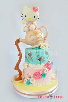 Love how the tea pot pours, and love the tea roses print on the cake below the pot.