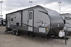 """COMFORTABLE AND FASHIONABLE TRAVEL TRAILER!  2016 Coachmen Catalina SBX 251RLS You'll love the added storage space of the under-bed storage! Maintenance on this model is a breeze with a fully decked, one-piece seamless walk-on roof! And when it comes time for travel, the self-adjusting brakes make towing easy! The 251RLS is 29'10"""" and has a shipping weight of 6052 lbs. Give our Catalina SBX expert Karin Florida a call 810-834-9851 for pricing and more information. Coachmen Rv, Under Bed Storage, Toy Hauler, Forest River, Motorhome, Travel Style, Recreational Vehicles, Storage Spaces, Breeze"""
