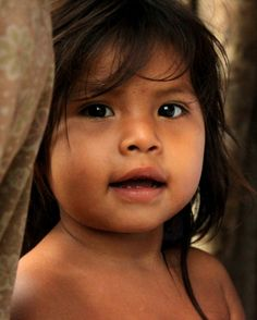 A Huaorani Indian child in Bameno, Ecuador.