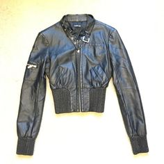 Bebe Moto jacket XS Black BEBE Moto jacket. Not real leather.  Great condition, slight tearing of inner liner, not noticeable.  Very flattering waist. bebe Jackets & Coats