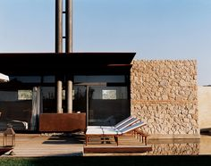 stone wall & industrial chimney. labics podere exterior deck in Tuscany