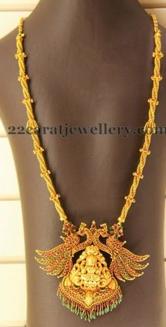 22 carat gold antique work long chain studded with rubies. Two dancing peacocks and Antique work Lakshmi pendant. Indian Jewellery Design, Indian Jewelry, Jewelry Design, Antique Jewelry, Gold Jewelry, Jewelery, Antique Gold, Temple Jewellery, Necklace Designs