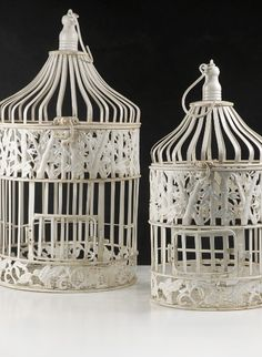 Wedding Birdcages Cream White Round  21 in. &15 in.  (2 cages)  $24 set of two. Maybe put on top of entertainment center?