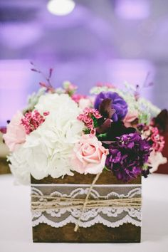 Centerpieces wrapped in lace and twine -- lovely!