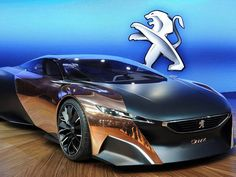 "Now, here's a concept car with a real concept: Peugeot's Onyx hybrid. Autoblog calls it ""a masterpiece in matte black paint"" whose ""most striking features are the two huge swathes of polished copper that adorn both sides."""