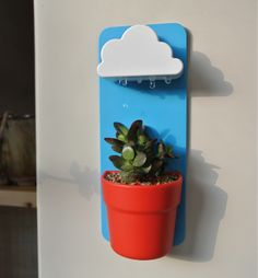 When settle for watering your potted plants by hand when you can water them via cute little wall-mounted rainclouds? That's the Rainy Pot for you, a conceptual