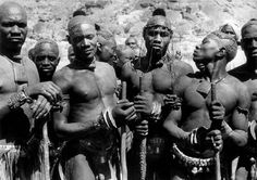 "Africa | The Nuba ""The lethal bracelets are used by the men of Kao-Nyaro to fight. They weigh two kilos and have two inch double flanges. The object of the bracelet seems to be to crack open the skull of their opponent"".  ca. 1949.  Kordofan, Sudan 