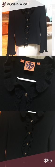 Tory Burch black Cardigan Tory Burch black soft cardigan with gold Tory buttons in size small. Runs true to size and perfect for everything.  Purchased this at Tory Burch store as well for $195. It's wool, cashmere and angora. It's in perfect condition Tory Burch Sweaters Cardigans
