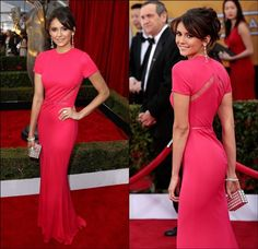 A mostly modest short sleeve red carpet look. Nina Dobrev's quiet campaign to achieve fashionista status continues apace with this sleek Elie Saab crepe gown in an eye-catching pink. Lacy cutouts on the sides and back add a little flair to the otherwise comfy-looking short-sleeved dress. Click on to see who else rocked a hot pink hue on the red carpet ...