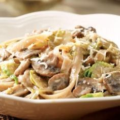 Recipe: Creamy Fettuccine with Brussels Sprouts & Mushrooms--Sliced Brussels sprouts and mushrooms cook quickly and cling to the pasta in our fall version of pasta primavera. Look for presliced mushrooms to cut prep time. Serve with a tossed salad.