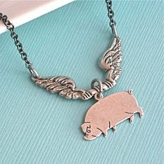 Silver Flying Pig Necklace - I love the idea of this. I just wouldn't want it to be too big/tacky though.