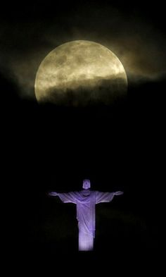 "A ""supermoon"" is seen above the Christ the Redeemer statue in Rio de Janeiro, Sunday, May 6, 2012, Brazil"