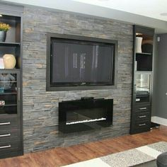 Basement Family Room Design Ideas, gas fireplace with wall mount TV on grey stone feature wall by Kim Hill Modern Fireplace, Fireplace Wall, Fireplace Design, Fireplace Ideas, Fireplace Stone, Fireplace Mounted Tv, Wall Units With Fireplace, Propane Fireplace, Linear Fireplace
