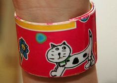 cat and butterfly pink recycled plastic bracelet by RecycledArts, $4.00