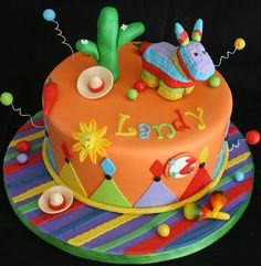Cake for little Landy who turned 2 on this past Cinco de Mayo! His mom wanted a colorful cake and a pinata donkey as a topper. Mexican Birthday, Mexican Party, Mexican Cakes, Fiesta Cake, Fiesta Party, Cupcakes, Cupcake Cakes, Colorful Cakes, Occasion Cakes