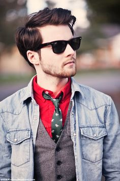 Red shirt, moss green tie, and grey vest.