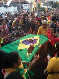 Meanwhile in the streets Brazilians aren't taking it lightly Brazil 1- Germany 7 in semifinals. World Cup 2014