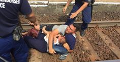 One couple laid down on the tracks, clutching a small baby in their arms and demanded they not be taken to refugee camps.