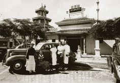 P.Y. Chong (left), his son (in the car) and four unidentified women pose with Chong's new LaSalle in front of his legendary Waikiki restaurant, Lau Yee Chai, 1937, Oahu, Hawaii.