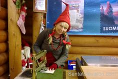 Santatelevision travel photo: Post elf at Santa Claus Post office in Santa Claus Village in Rovaniemi in Lapland in Finland – arctic circle