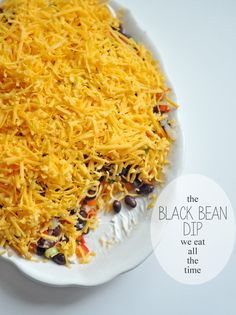 Black Bean Dip 1-19oz can of black beans, rinsed 1/4 cup chopped onion 1-2 cloves garlic, minced 2 Tbsp lime juice 1 Tbsp olive oil 1/2 tsp ground cumin 1/4 tsp red pepper 1-8oz cream cheese, softened 1/2 of two peppers. green, red, orange or yellow 2 green onions, chopped 1/2 (or more) shredded cheddar or Monterey Jack cheese