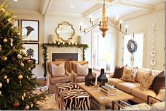 Calm color palette - camel, chocolate brown.  Like the greek key pillows and the zebra ottomans!